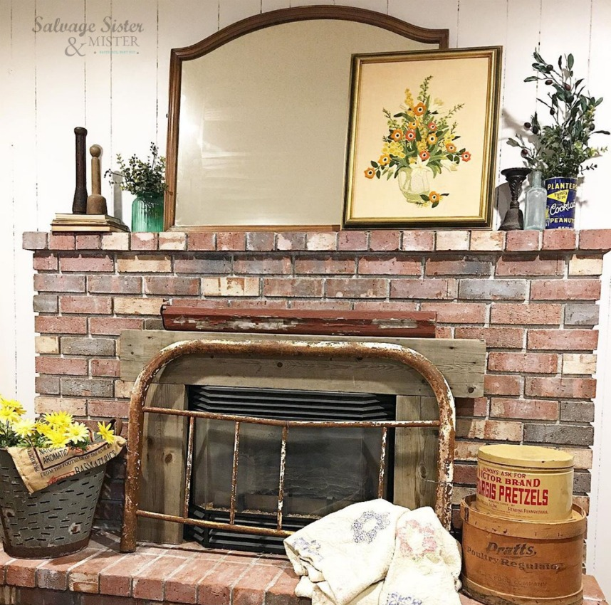 Our simple whitewash fireplace diy project to update the dark brick.  Find details on salvagesisterandmister.com