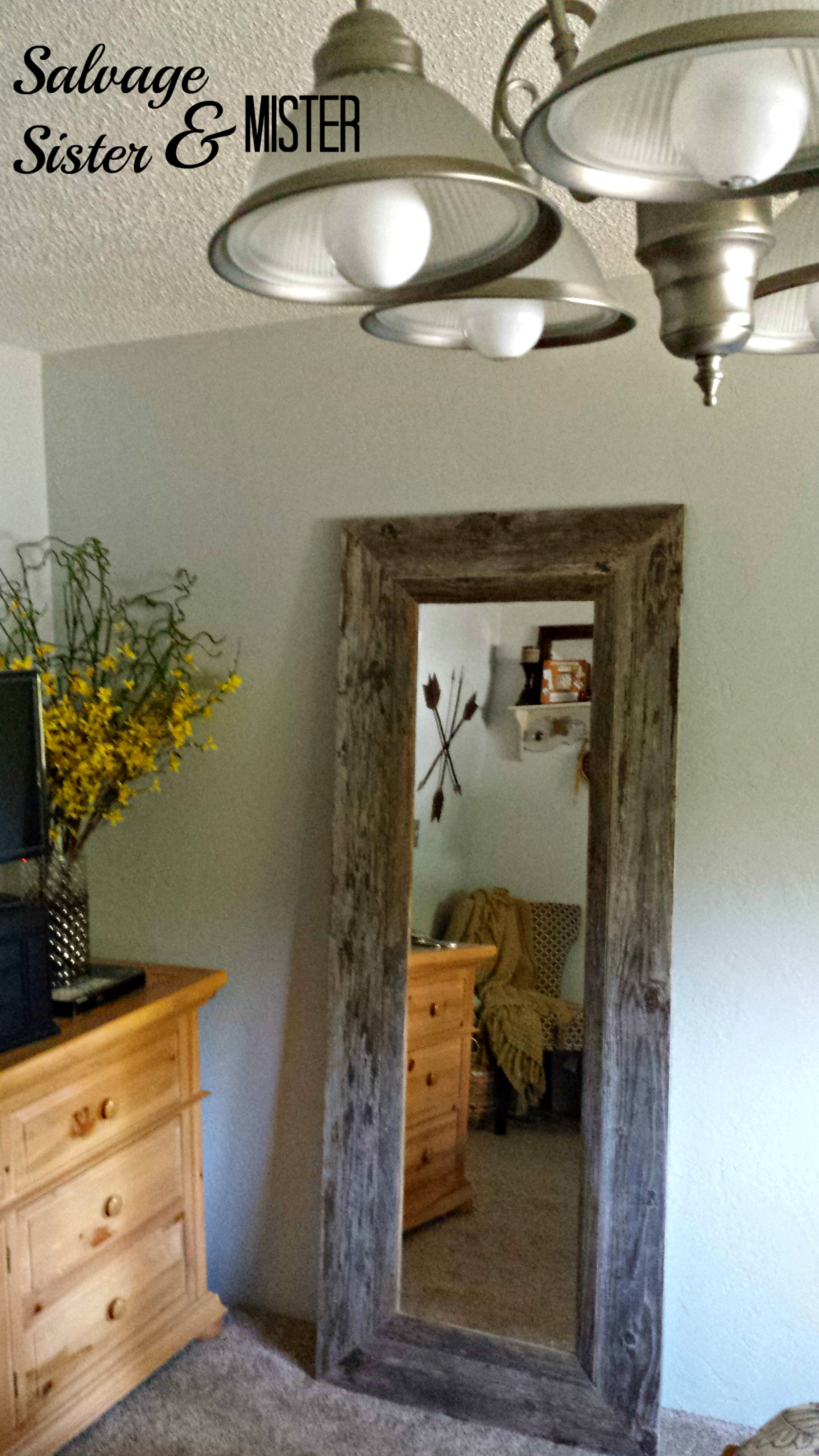 Pottery barn inspired mirror made from a goodwill mirror. Frame made from salvaged wood. DIY project under $50 instead of a $500 mirror. Full tutorial.