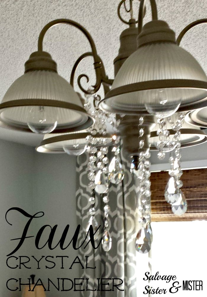 Standard light fixture turned into a faux crystal chandelier.  Inexpenisve light fixture idea.  www.salvagesisterandmister.com