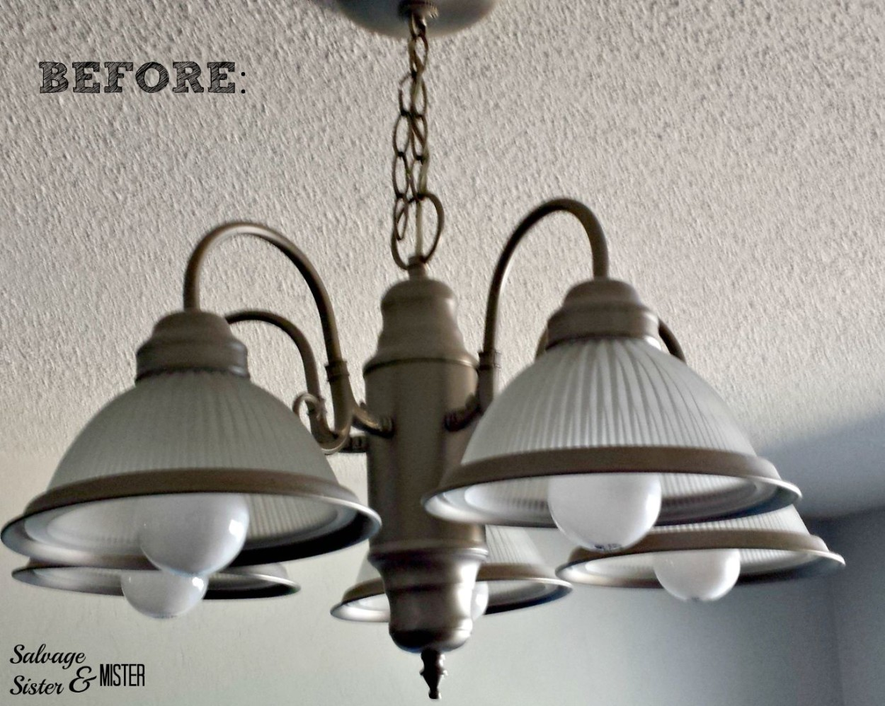 turning a standard light fixture into a faux crystal chandelier.  www.salvagesisterandmister.com