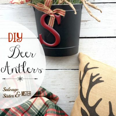 DIY Deer Antlers. Using a branch and kraft or packing paper. Easy craft using supplies you already have on hand. Quick and simple holiday decor. Perfect for a rustic Christmas theme. You can use them in wreaths, on your tree, or in this hanging basket.