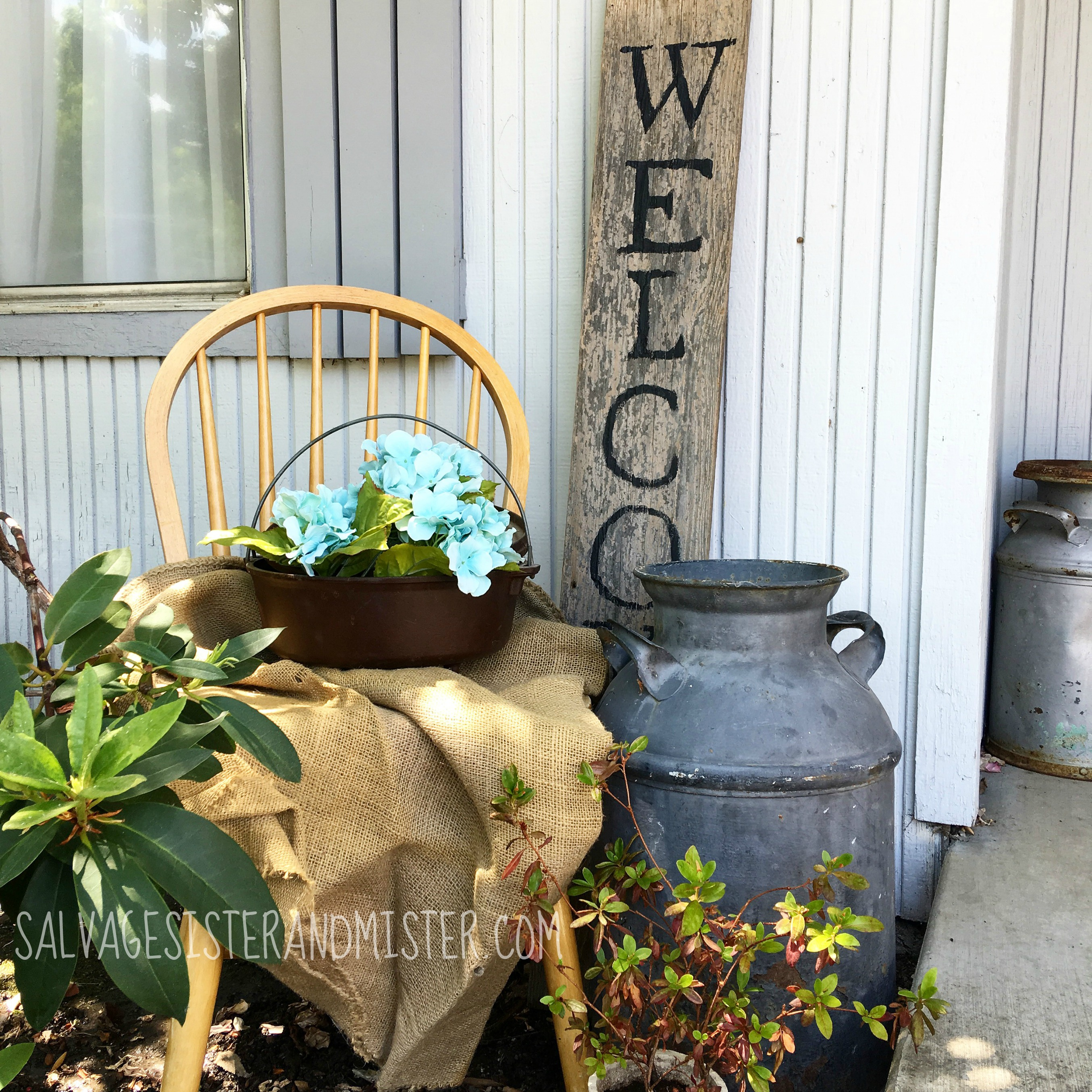 "DIY Salvaged Wood welcome sign for the front porch.  This really is super simple and super inexpensive.  Just a few ""junk"" items make a nice welcome to any home exterior.  This is just one of several salvaged wood projects."