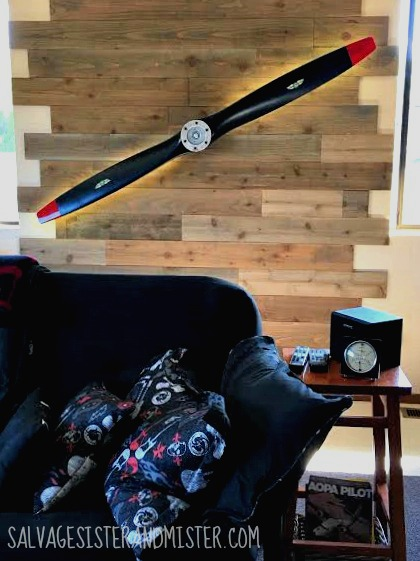 """Participaiting in the One Room Challenge with an overhaul to our extra room. Turning it into a game room. We added this DIY """"reclaimed"""" wood planked wall and a propeller. Budget decor as the wood was cheap and the propeller free."""