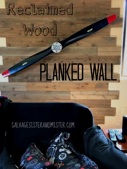 Installing a faux reclaimed wood planked wall in our game room. This was cost effective and a great focal point for the room. The design is staggered to offset the two open windows on either side. Home design/home decor