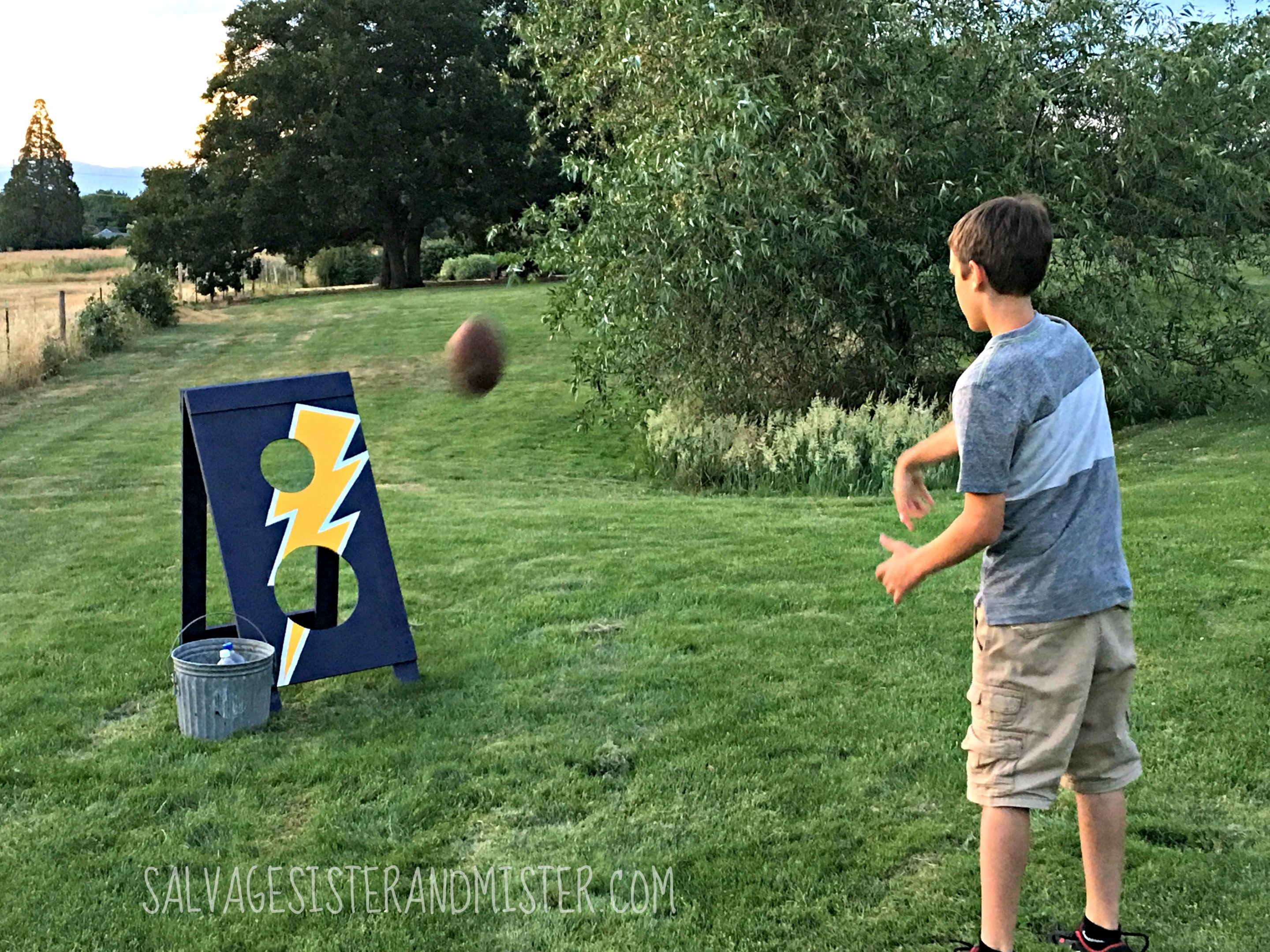 Fun family time with this Father's Day Football Toss from The Home Depot DIY Workshop. REgister to make this and/or amny other projects for free. Whether you want to learn to build, make something, or have a fun project the kids can build Home Depot has wonderful projects to get you going. #sponsored #DIYWorkshop
