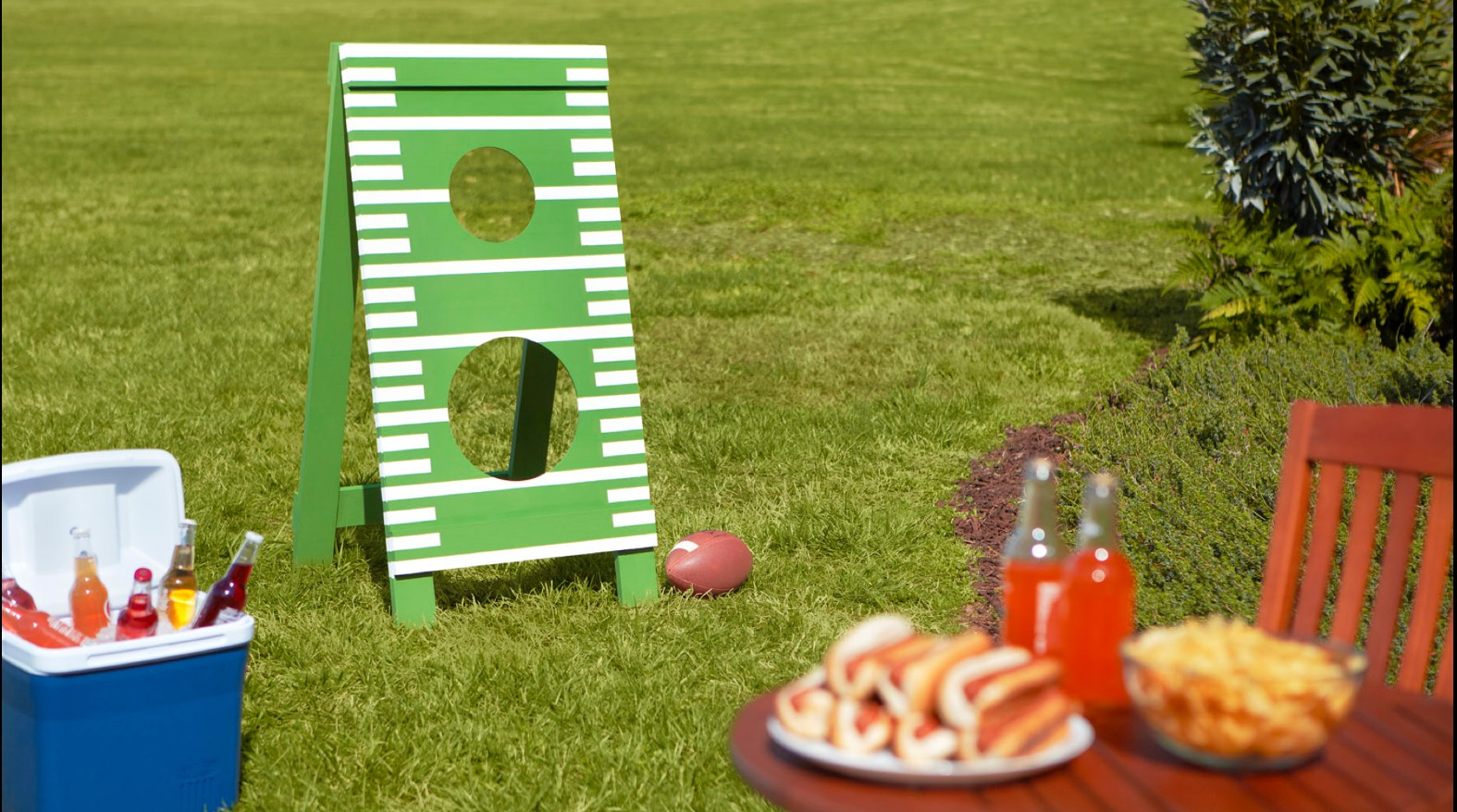 DIY Father's Day Football Toss. Do you realize you can make this for FREE at the DIY Home Depot Workshops? Perfect for a family gathering. What Dad wouldn't love this? Perfect gift idea.