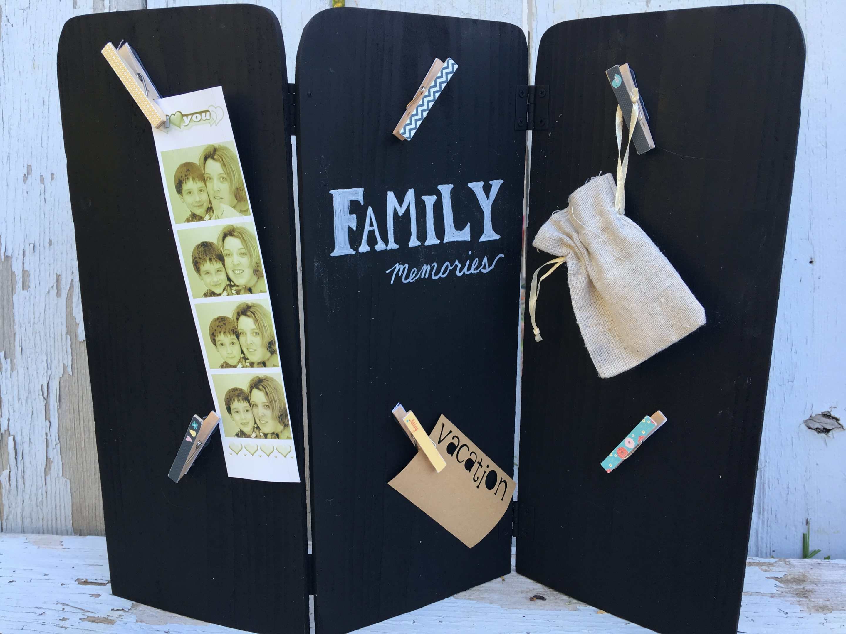 A $4 thrift store trifold screen is turned into a family memories center. You can change out pictures and memorobilia as desired. Super easy DIY project that anyone can do.