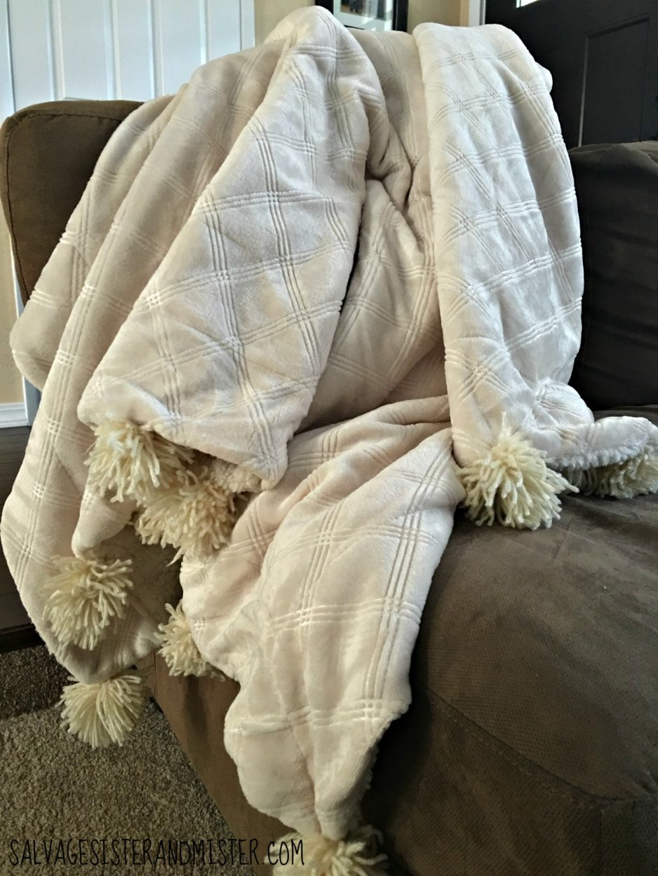 diy pom pom blanket made from an on sale sherpa blanket and some thrift store yarn