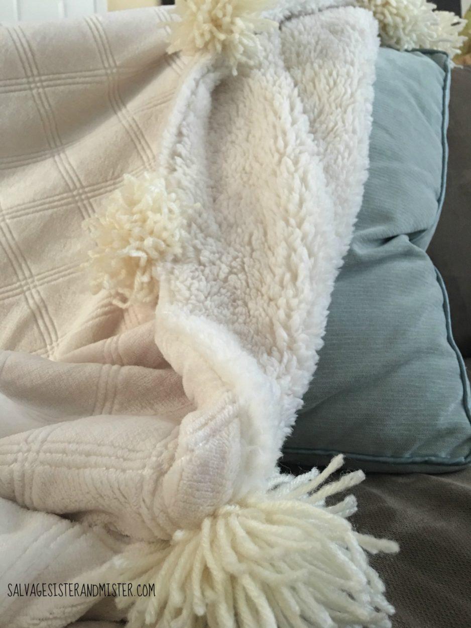 turning a sale sherpa blanket into a pom pom blanket was easy this diy pom