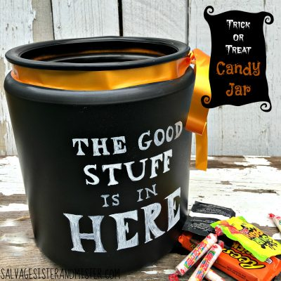 Thrifted glass jar with missing lid is turned into a trick or treat candy jar. After halloween you can take off the ribbon and use it in your pantry to hold all the good candy. The chalkboard lettering can be changed to whatever you like at anytime. Easy DIY project. Fun for the kids.