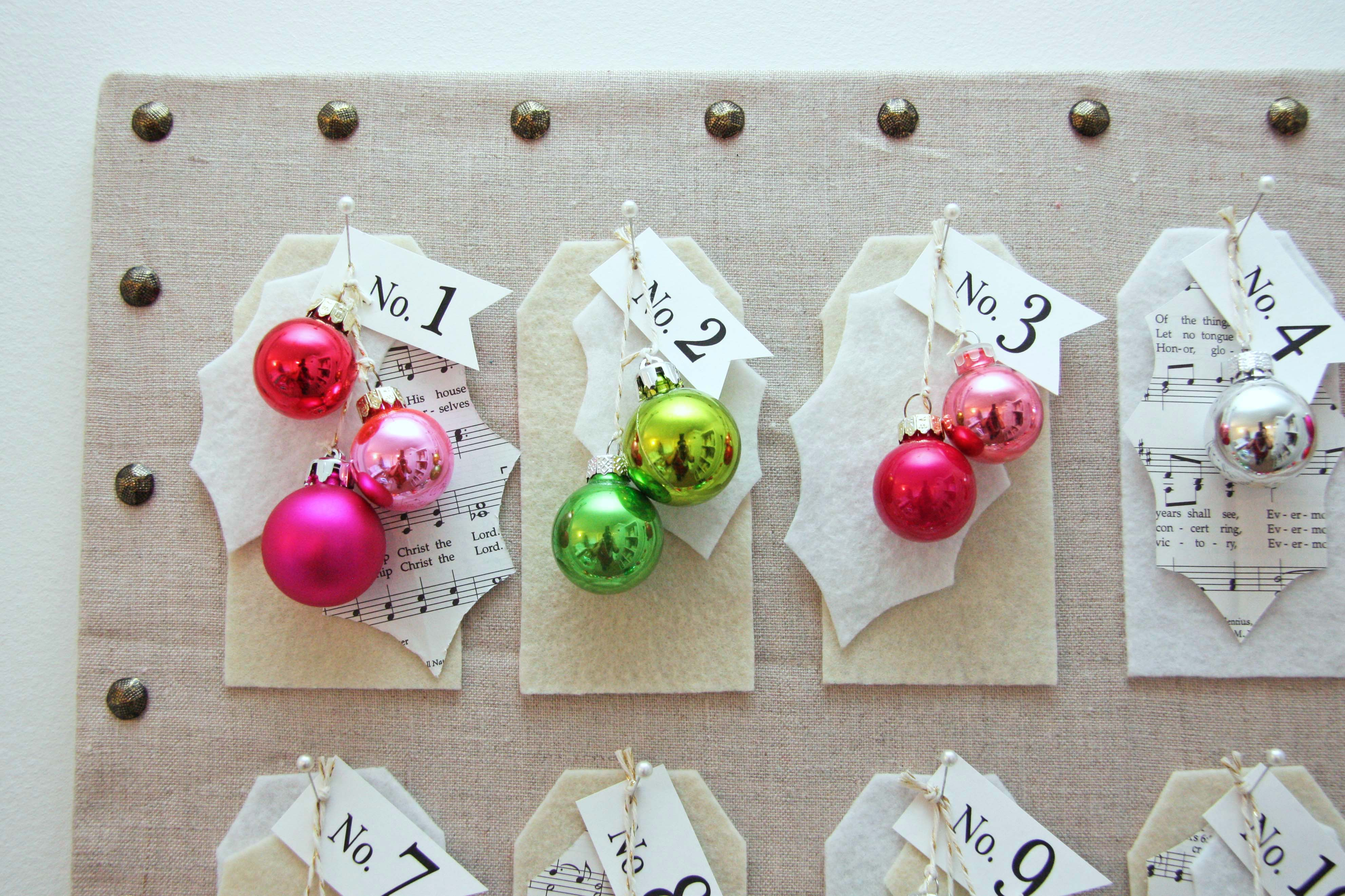A simple Christmas countdown board.  Great to use up items you have around your craft room.  This is a simple craft idea.  Go to the blog for the full tutorial.