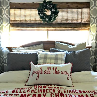 A duvet covers makes for an easy change to your decor. This salvaged christmas home tour shows how to decorate using what you have, upcycled items, thrifted and flea market style. The bedroom was a goodwill wreath and a duvet cover with one extra pillow to decorate for the holidays.