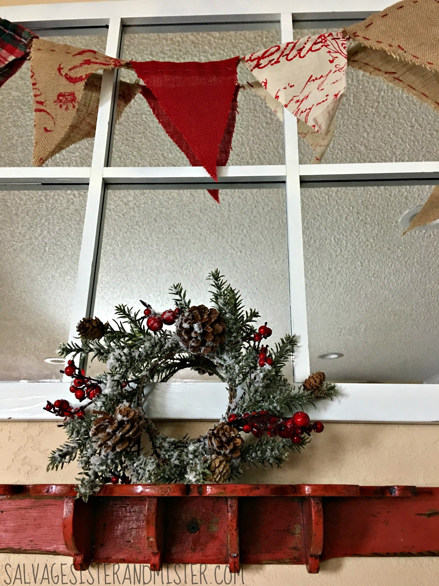 salvaged christmas home tour. Simple touches like a banner and wreath make for easy holiday decor