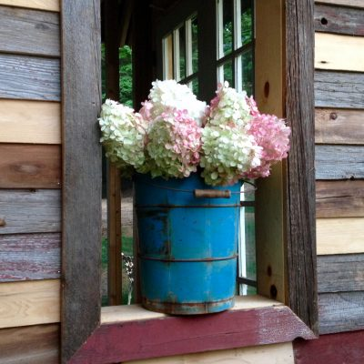 Upcycled garden shed made with salvaged materials. Find out how this shed was made using what you have. A #ssmfeatureme project. Reuse/DIY