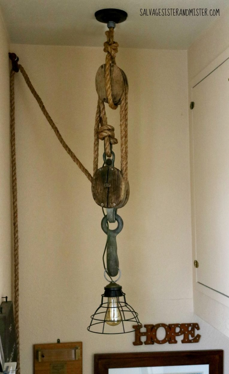 We upcycled this bargain pulley (block and tackle) from the Restore into a pulley light. This DIY project was cheap and fite in with our rustic, industrial, and farmhouse decor style.