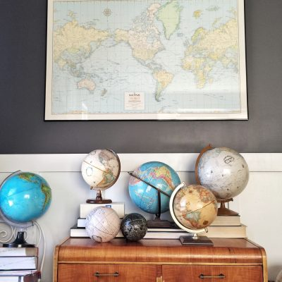 Maps and vintage globes are fun to decorate a home with. You can often find these at thrift stores, fle markets, or year sales. See what else you can decorate with on this vintage home tour.