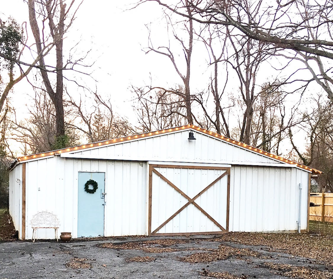 A before and after renovation on a shed. In a weekend this DIY project make all the difference to this large shed. Materials on hand, a lot of elbow grease, and very little purchased items make this shed exterior have fixer upper appeal. Come see what was done.