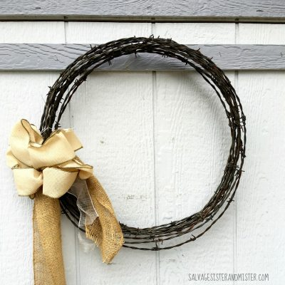 A crazy simple barbed wire wreath. All using items we already had to decorate the outside of our home. Use what you got. Plus it cost us nothing. Simple to make so it doesn't take a ton of time. This DIY project is a great way to reuse barbed wire. Upcycle - repurpose