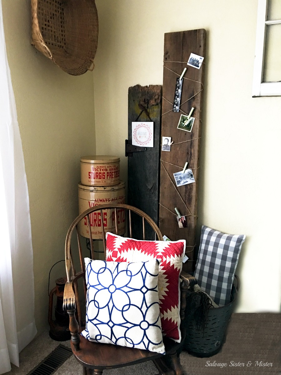 A reclaimed wood picture display. Easy way to fill a corner in a room. Easiest project ever. Using what we have to decorate with thrifted items and recliamed wood. Easy to change up using different pictures. Salvage Designs
