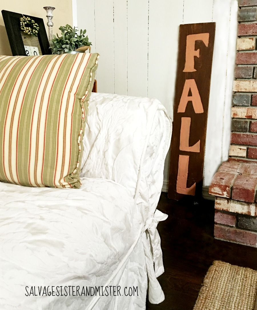 A Reversible rustic holiday sign - Fall and JOY. This was made from a piece of wood from a free pile. It had some damage and needed some more diy repair to get it ready. Now it can be used for a front porch or any any holiday decor easily.