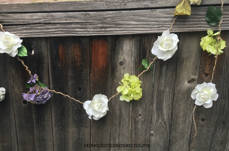 How to make an artificial flower garland using thrift store flowers. #craft #flowergarland #diy salvagesisterandmister.com