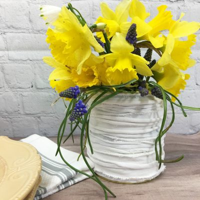 Here's a way to upcycle an old t-shirt and a tin can - Farmhouse Tin Can Vase Upccyle Craft - Found at Salvage Sister and Mister.com #ucpcyle #farmhouse #reuse