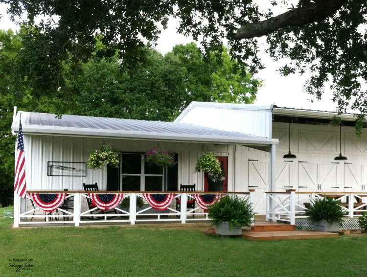 Patriotic home exterior.  This home was just an average plain home until the home owners completely remodeled it into a fixer upper dream.  This exterior farmhouse makeover is amazing as featured on salvagesisterandmsiter.com