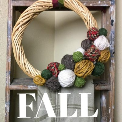 Thrifted DIY FALL Yarn Ball Wreath is a fun craft and a great way to use up leftover yarn. A simple and inexpensive craft to make for your own home or for a gift. You can make this for whatever season it is or just in your home colors. Fun home decor craft and a great project to do for ladies night. #craftnight #bargaincraft #craft