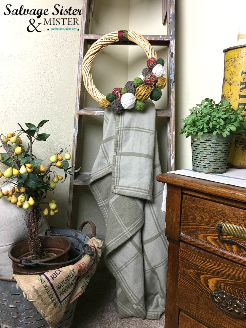 A perfect craft for kids or adults. Super simple and inexpensive to create. Great for craft night. Make this Thrifted DIY Fall Yarn Ball Wreath for your home or as a gift. You can customize it to your colors and holiday. #easycraft #homedecorcraft #wreath