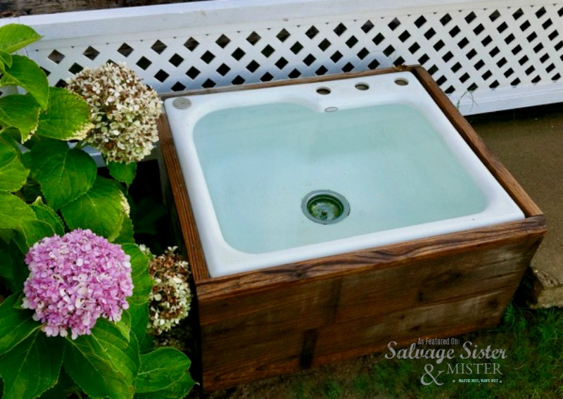 A kitchen sink from a remodel is used as a dog watering station #upccyle #reuse #dog as featured on salvagesisterandmister.com