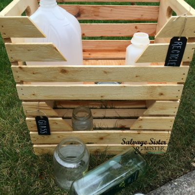 Need to seperate out your recycle items? Make you own recycle center with this project - DIY Home Recycle Bins from wood crates. Great way to organize your recyclables. Project found on salvagesisterandmister.com #recycle #organize #recyclebins