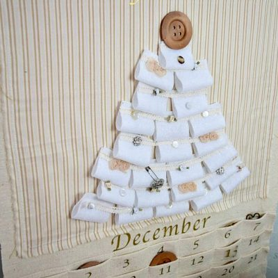 What to do with oldds and ends craft supplies? Why not make this upcycled advent calendar from fabric scraps? Great way to start the advent season #adventcalendar #ucpcyle found on salvagesisterandmister.com