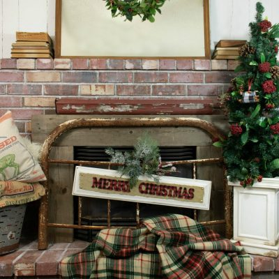 Fireplace mantel rustic and vintage decor and a DIY Christmas cabinet door sign project on salvagesisterandmister.com #upcycle #christmasdecor #repurpose