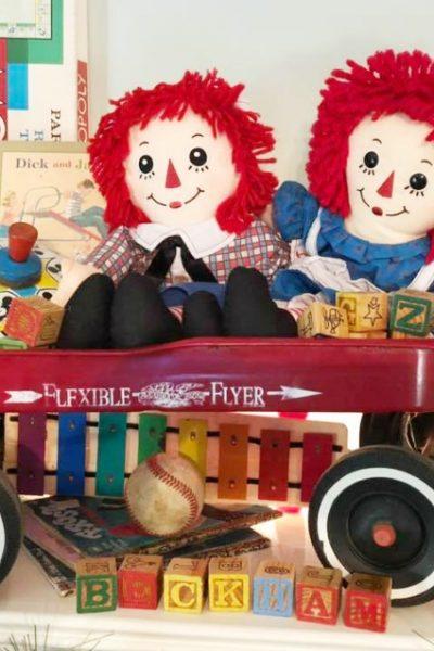 Old toys used to create a festive Christmas mantel on salvagesisterandmister.com