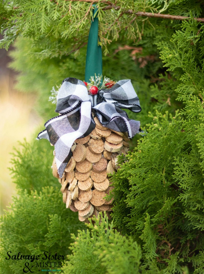"""If anyone ask, I'm drinking all this wine to collect corks for a project I saw on Pinterest."" and here's the prject - WINE CORK PINE CONE ORNAMENT holiday craft. Perfect for a rustic or farmhouse Christmas tree. #repurpose #holidaycraft #pinecones #winecorks"