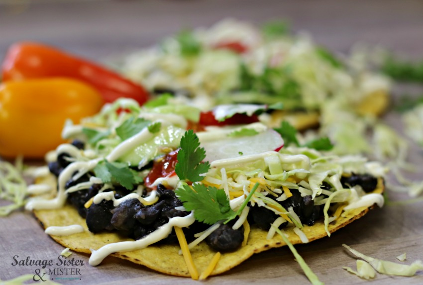 Need a quick and tasty dinner recipe?  This is a family favorite - quick black bean tostadas for your meal plan.  You can add meat or keep it vegetarian.  On salvagesisterandmister.com #quickrecipe #mealplanning #simplerecipe