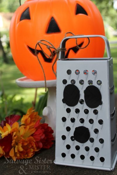 Turn an old grater into this fun ghost grater craft. Upcycle - Reuse- repurposed - budget decorating on salvagesisterandmister.com