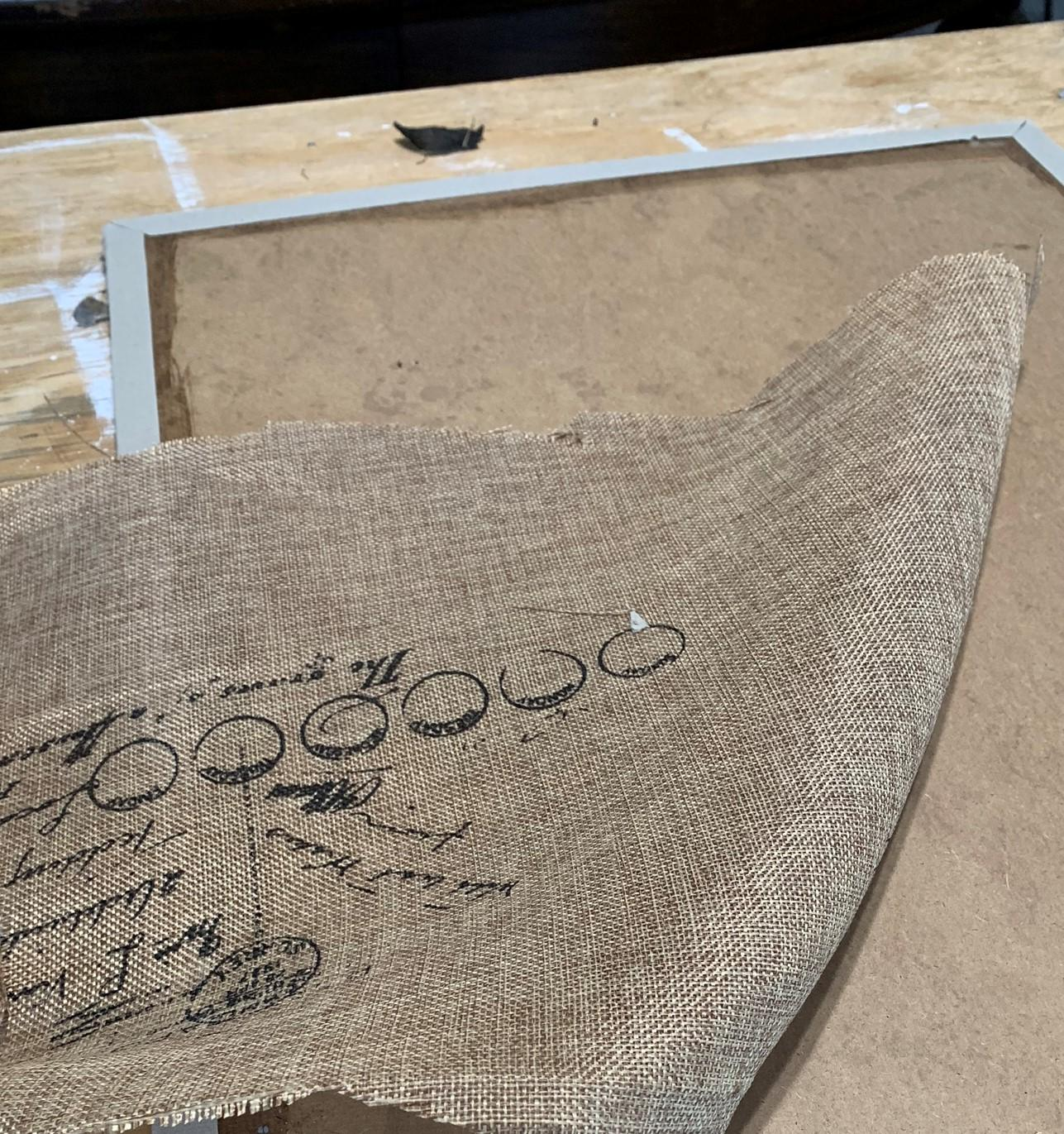 removing burlap from old photo memory board on salvagesisterandmister.com