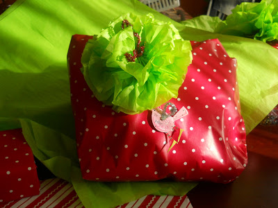 Tissue paper flowers as holiday bows.......