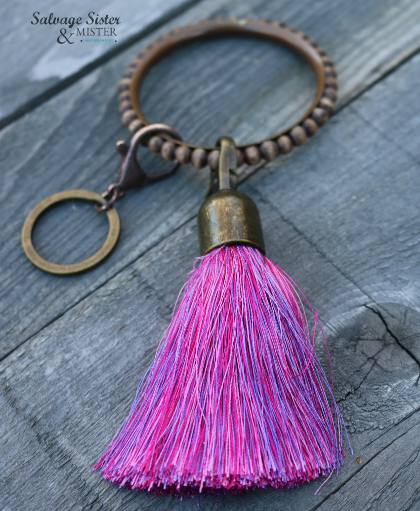 Creating a DIY key ring bracelet - create for yourself or to give as a gift. Using a thrifted bracelet this is a perfect way to key your keys close by. Great office gift and is certainly a way to not loose your keys -organizing. Find more info at salvagesisterandmister.com