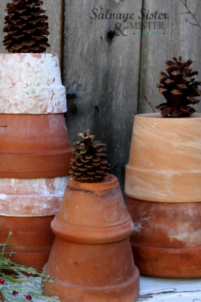Using my garden pots to create a terracotta Christmas tree. Perfect for outdoor holiday decor or a garden bench. Simple and inexpensive decoration. See more at salvagesisterandmister.com