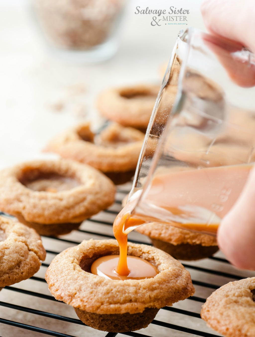 Filling brown sugar cookie cups with caramel for these tasty treats. Great for a cookie exchange or with your favorite coffee or tea. Give as a gift. Add chocolate and nuts for a turtle cookie cup version. Get recipe on salvagesisterandmister.com