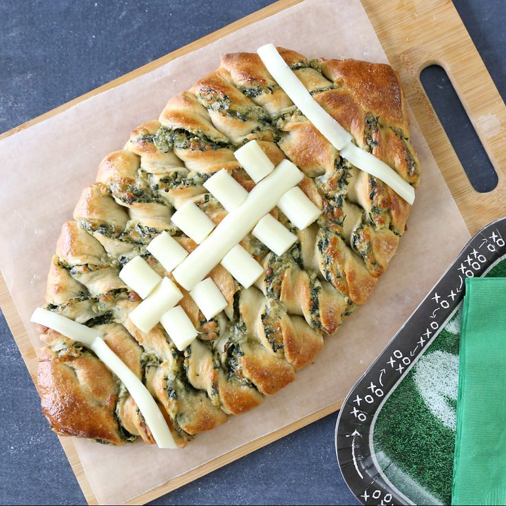 Football shaped spinach dip breadsticks