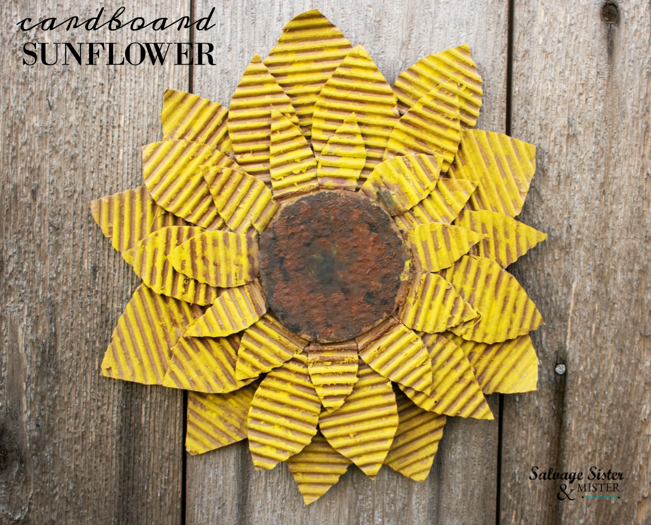 Create this unique craft using an old box. A fabulous reuse, repurpose, upcycle project that is perfect for a table decoration, wall decor, party decoration, and more. Get this diy cardboard sunflower tutorial on salvagesisterandmister.com