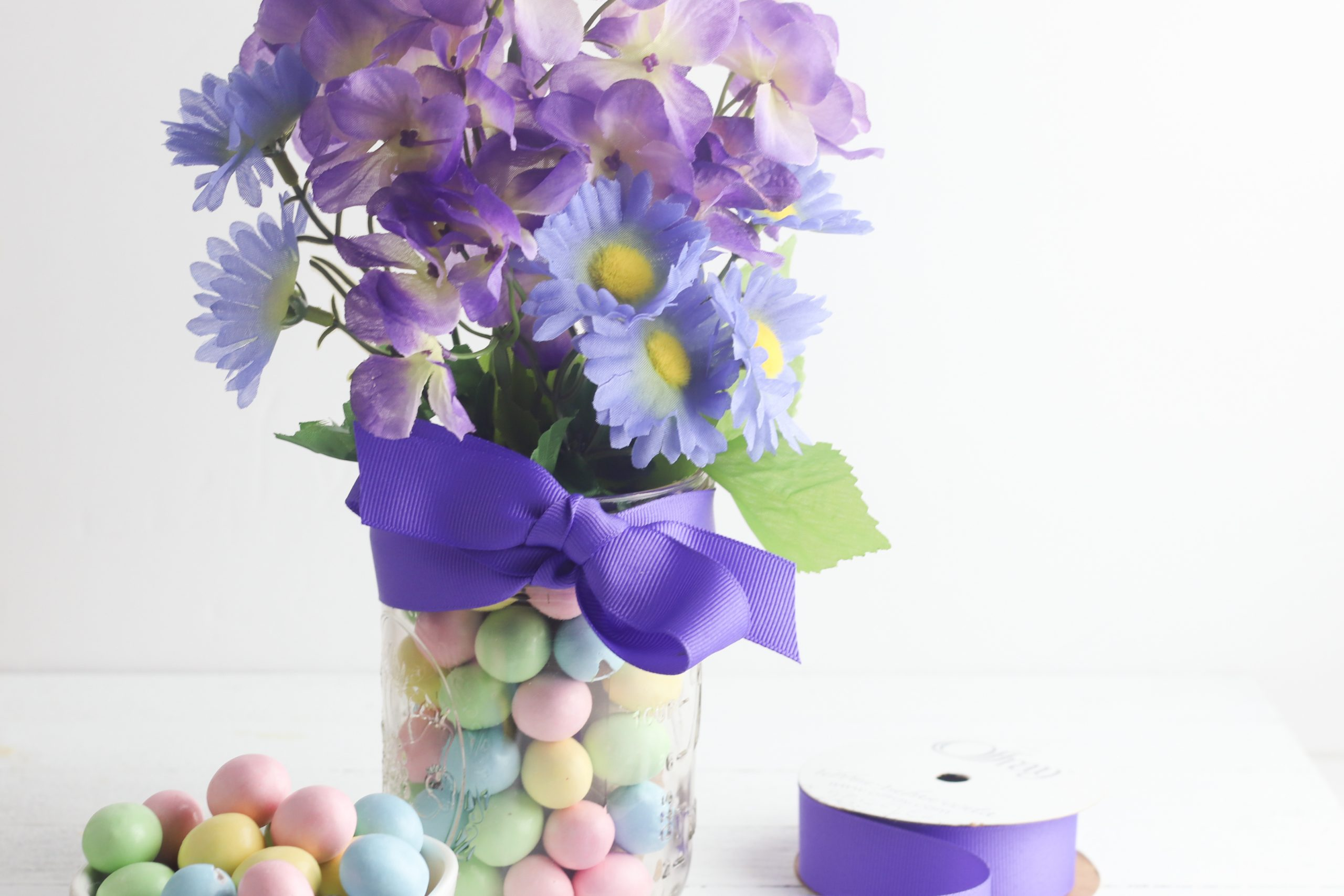 Mason jar Ester vase with candy and flowers found on salvagesisterandmister.com