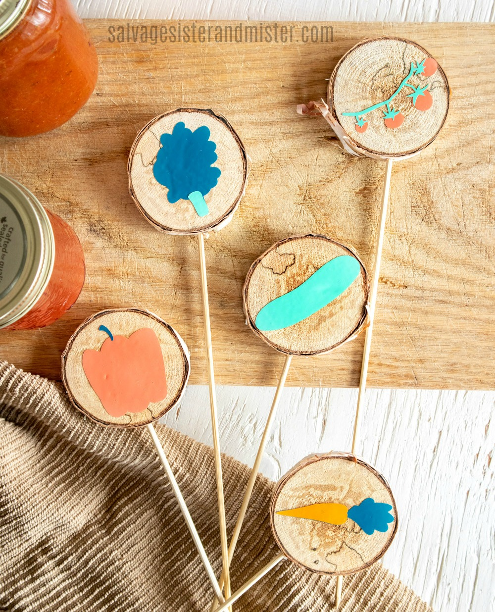 Turn a broken tree branch into fun little garden markers with this DIY tutorial on salvagesisterandmister.com